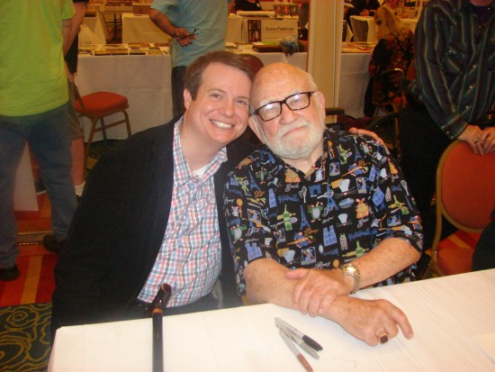 Ed Asner poses for a photo with a fan.