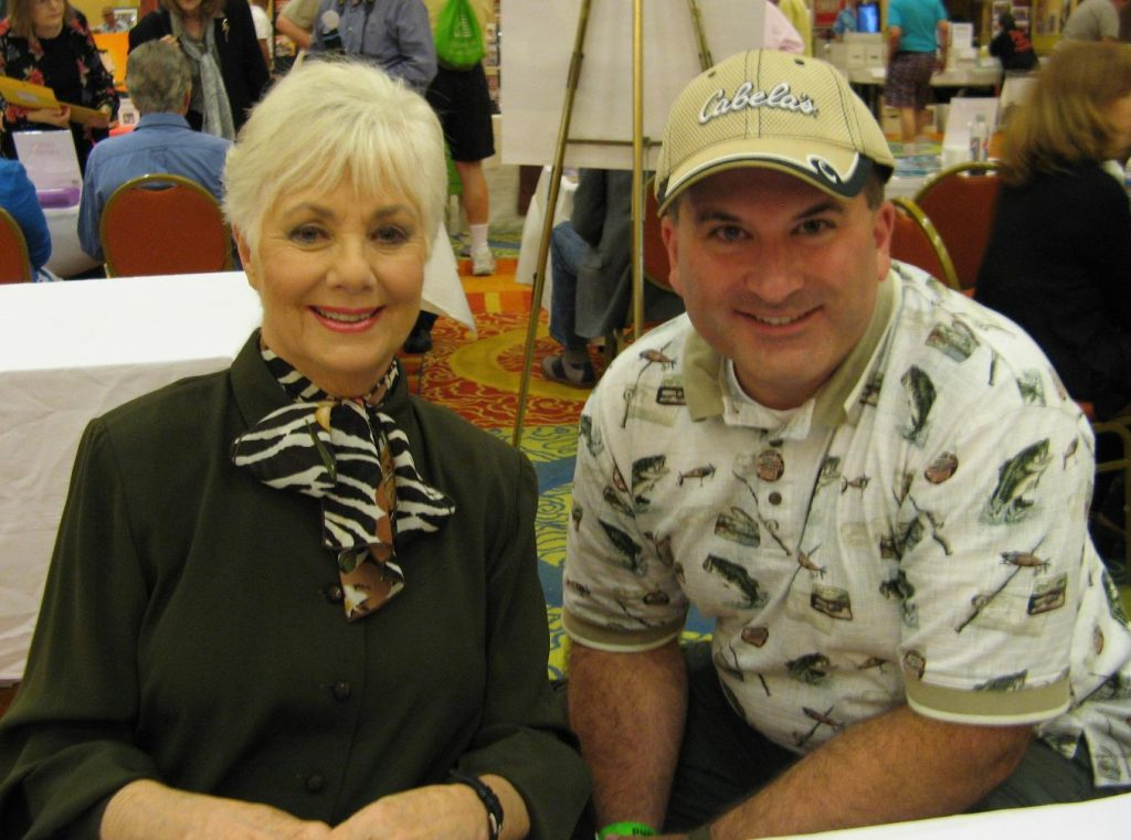 Shirley Jones poses for photos and signs autographs.